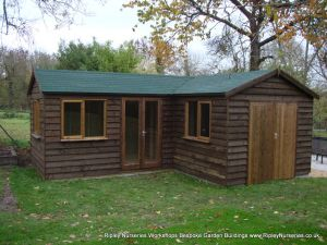 Heavy Duty Workshop 22x20 'L' shaped, Stained Featheredge Cladding, French Doors, Joinery Windows and Felt Tiled Roof.
